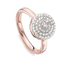 This beautiful ring features pavé set diamonds totalling 0.1647 carats. The diamond button measures 10.8mm in diameter and the band measures 2.3mm. Wear alone or stack with other diamonds and gemstones to create your own unique look.