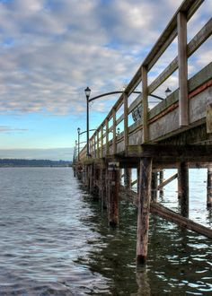 ~PIer 23~ #structure   #supports   #ocean   #water   #ripples   #scenery   #bench   #lights   #photography  by Ernie Kasper