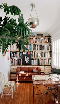 The study is outfitted with a Cassina settee, originally designed by Le Corbusier, Pierre Jeanneret, and Charlotte Perriand, and a Dan Johnson table beneath a 1930s French chrome pendant | http://archdigest.com