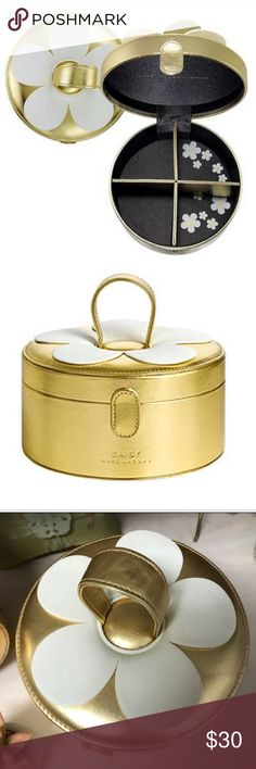 Marc Jacobs Daisy Train Case Marc Jacobs Gold & White Daisy Train Case/Cosmetics Case with removable dividers & snap closure. In Used, but Good Condition! Several small flaws as pictured. Marc Jacobs Bags Cosmetic Bags & Cases
