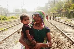 #MothersLove, Mumbai 2016.  A woman labour holding her child. She was cleaning the railway tracks. Her child was crying as he was hungry and she wiped his face with her dirty hands. The child's legs gets dirty while roaming on the track. . #mumbai #bombay #india #incredibleindia #potrait. Atulya Bharat !!