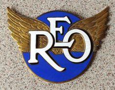 REO motor car enamel car badge