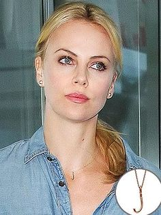 Charlize Theron wears an initial necklace with the initial of her newly adopted son Jackson.
