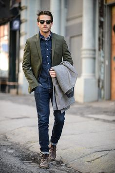 A grey overcoat and navy slim jeans are a great outfit formula to have in your arsenal. Dark brown leather casual boots are a nice choice to complete the look.   Shop this look on Lookastic: https://lookastic.com/men/looks/overcoat-blazer-denim-shirt/14529   — Black Sunglasses  — Navy Denim Shirt  — Olive Blazer  — Grey Overcoat  — Navy Skinny Jeans  — Dark Brown Leather Casual Boots