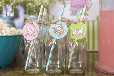 Milk bottles at a girly dragon Viking birthday party! See more party planning ideas at CatchMyParty.com!