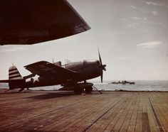 A Grumman F6F Hellcat fighter of USS Randolph (CV-15) parked on the port catapult, March 1945.