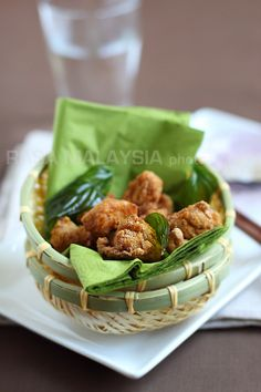 Salt and Pepper Chicken - fried chicken marinated with five-spice powder and served with fried basil leaves. #chicken