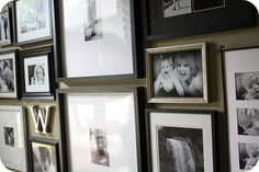 This gallery wall is AWESOME! Plus she uses the same trick I do for keeping the pictures straight.