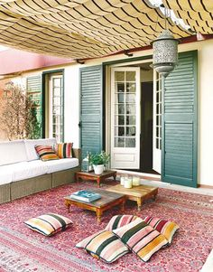 LOVE the canopy.   Colourful Patio Lounge | House & Home | Photo via Home Design Blog