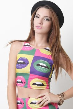 Make a fashionably fun statement in the Lip Print Crop Top! Featuring color block lip print, stretch knit, crop style, round neckline, sleeveless, and asymmetrical hem