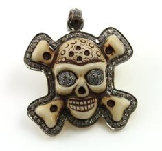 Pave Diamond Skull Pendant surrounded in diamonds by Beadspoint