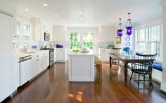 Gorgeous kitchen.. just love the windows, white cabinets and floorboards.. Nantucket residence, MA. Beach Glass Interior Designs.