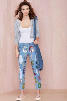 Spell it out in these light wash jeans with sequin letters at front and distressed detailing.