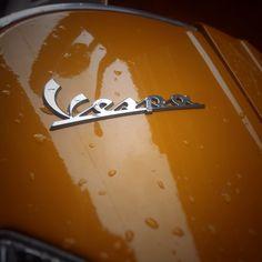 Orange Vespa in the rain