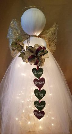 Best 12 This beautiful lighted angel is made with a tomato cage base. Has 100 white strand lights, and stands around 3 feet tall! This item can be personalized with family names, or the ribbon can be embroidered (pictured in other listings). Christmas Angel Decorations, Christmas Angel Crafts, Diy Christmas Ornaments, Christmas Projects, Simple Christmas, Holiday Crafts, Christmas Wreaths, Christmas Bulbs, Crochet Ornaments