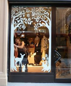 Love this do-able shop window design. Stencils, size and silver leaf.