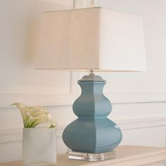 "Porcelain Square Gourd Table Lamp Chic table lamp with a modern gently curved square shape. Available in several beautiful colors to complement your decor. 150 watts max, 3 way medium base socket. UL LISTED. (25""Hx14""W)  Linen hardback shade (12.5x14x10)."