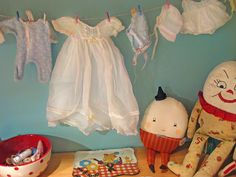 Vintage baby clothes and toys