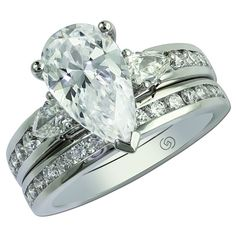 Gottlieb & Sons 29561 - Pear shaped three stone bridal set with channel set round diamonds in the band.