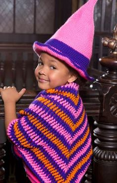 Little Witch Hat & Shawl - Crochet a hat and shawl for your charming mini witch! Customize the look by using her favorite colors, which we're betting are pink and purple.