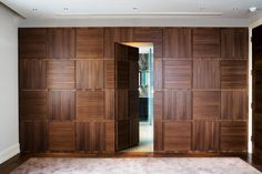 Floor to ceiling wardrobe with integrated bathroom door- rotational grained & book-matched American walnut veneer - design Lamont Interiors. Joinery INTERIOR-iD