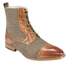 For Melchoir!  Tweedle-Dee-Details! Our Men's Tweed Boot in Tan set the pace for on-point 19th century style thanks to a classic herringbone print and leather spectator accents.Boots feature a 100% leather lining, upper and sole, 1-inch heel and lace-up entry. Ankle-height shoe measures 7-inches tall from the sole of the foot to top of shaft (excluding heel). Imported. Available in men's sizes 8-13.Offered in several colors.