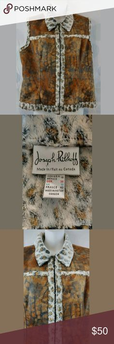Joseph Ribkoff Size 10 Faux Fur Vest Hello and thank you for checking out my items! We list new items every single day so check back often for great deals!  Women's Joseph Ribkoff Vest  US Size 10  Faux Fur and Faux Leather  100% Polyester  Animal Print  Full Zip  21 inches across chest from pit to pit  23 inches from shoulder down to end Joseph Ribkoff Jackets & Coats Vests