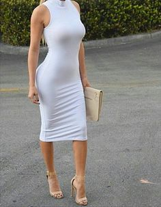 Ridiculous curves in a tight white sleeveless dress and strappy nude high heels