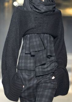 This fascinates me. I love these odd cropped sweater shrugs. Paired with a suit like this is interesting but may ultimately make me crazy - Yohji Yamamoto