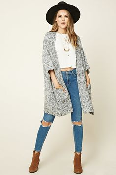 A marled knit cardigan featuring an open front, two patch pockets, and short dolman sleeves.