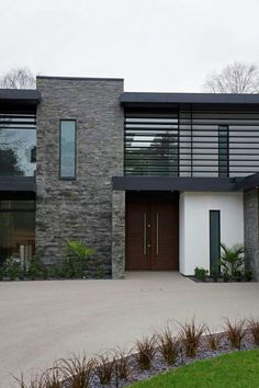 Inspiring Display of Natural Textures Nairn Road Residence in Dorset, England is part of Facade house - Designed by David James Architects in Dorset, England, Nairn Road Residence displays a sober modern exterior appearance