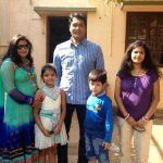 Aditya Srivastava with his wife and children
