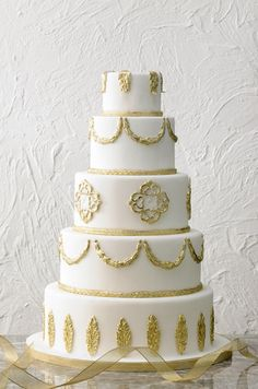 White & Gold wedding cake By Papillion Couture Cakes