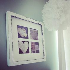 Painted and distressed frame, decoupage hearts.  Paper pom poms By pumkinvintage