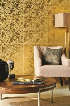 Honfleur Gold glass tiles feature a textured surface, as the pattern is etched to create depth. Bright, glamorous gold creates a sense of luxury wherever they are used.