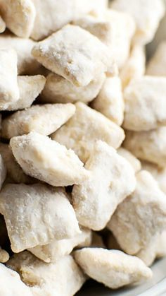 Fluffernutter Puppy Chow ~ The delicious taste of fluffernutter (peanut butter + marshmallow) wrapped around crunchy Chex cereal... It's the perfect snack food in just 15 minutes!