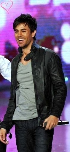 Photo of awesome smile for fans of Enrique Iglesias. Enrique's smile is really awesome