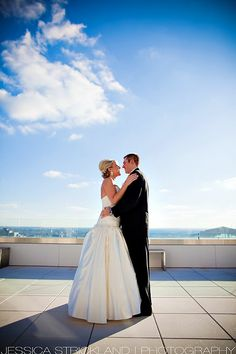 The newlyweds capture the special moment on the roof top of Conrad Indy.