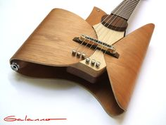 Leaf Guitar by Ezequiel Galasso, via Behance —too cool to play I imagine