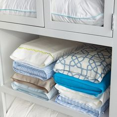 Tips & Tricks for your home: fold your flat sheet, fitted sheet, and one of the pillow cases then place them all into the second pillow case. Simply stack your neat sheet packets up in your linen closet