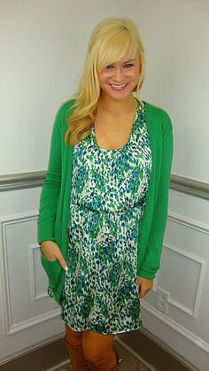 An easy little tank dress with a fresh, springy print! It has a cute, blouson fit with side pockets... oh how we love side pockets ;) Complete the outfit by adding our kelly green cardigan!