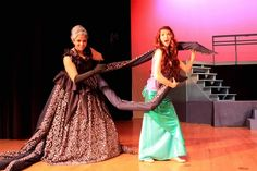 """Ursula & Ariel (fooling around) Princeton High School's March 2015 Disney's Little Mermaid Jr.  Photo (c) Jeff Schlesinger. Ursula's tentacles are pool noodles threaded on nylone rope, tied to a belt. Underskirt is an old Urban Outfitters bedspread. Top is a cut-down prom dress. Ariel's """"tail apron"""" is Theatre House Reptile Hologram Spandex (we added a tulle frill to the apron for final production)."""