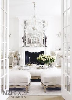 White chic french provincial antique living lounge room with french doors venetian mirror & ottoman