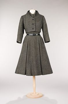 'Virevolte' ensemble | Christian Dior (French, 1905-1957) | France, Autumn/Winter 1955 | Material: wool | Emphasis on a nipped waist was the primary characteristic of Christian Dior's designs. This day ensemble features another Dior hallmark, the cropped jacket, to create the same look. Paired with a box-pleated skirt, the jacket skims the waist, accentuating the hourglass shape | The Metropolitan Museum of Art, New York