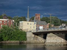 """A view of """"Uncle Sam's"""" Bridge,West Bridge St ,Catskill,N.Y. spanning the Catskill Creek with storm clouds blowing in."""