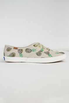 Bring the whimsy to every park picnic with fruity feet. - Printed fruit shapes created with animal prints - Natural cotton lace with gold metal aglets - Linen upper - 4 eyelet lace up sneaker - Soft b
