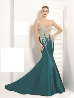 teal prom dress with silver/white detail