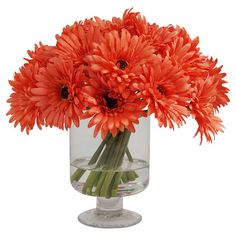 Bring a cheerful touch to your decor with this charming faux gerber daisy arrangement, showcasing an array of silk blooms in a glass vase with illusion water...