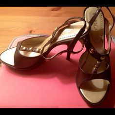 Brown Colin Stuart pumps from Victoria secret Size 6.5 brown pumps with gold round studs from Victoria secret website. Wear and tear on the straps on the inside. Colin Stuart  Shoes Heels