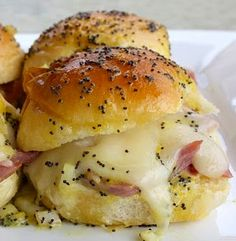 Warm ham and cheese sliders with a tangy mustard sauce are perfect for gameday.